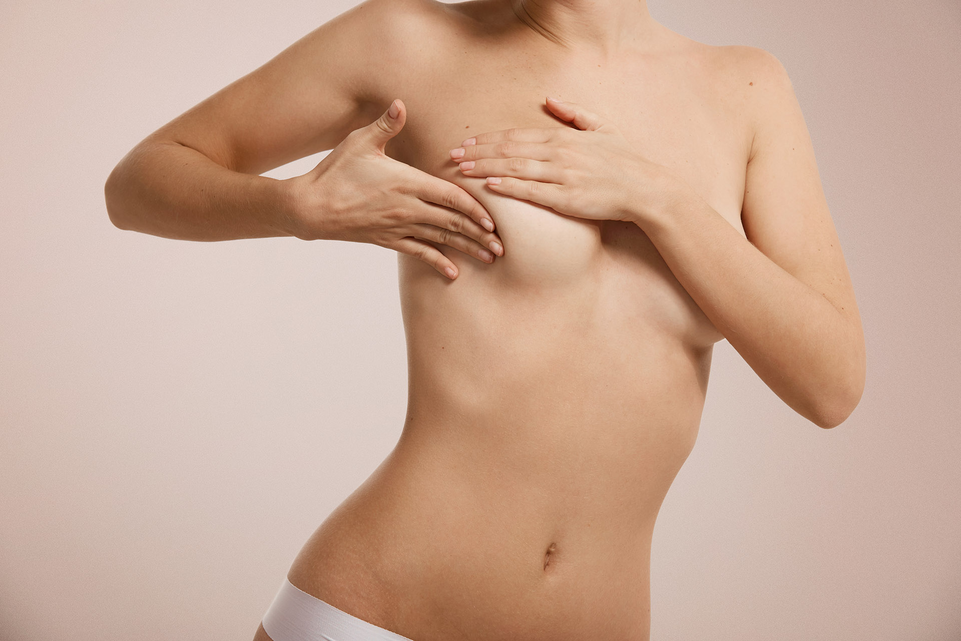 Breast cancer concept – woman checking her breast.